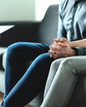 Counseling and therapy for couple and family. Adoption, psychology or psychotherapy concept. Session with psychiatrist or psychologist. Husband and wife with marriage counselor. Man, woman and doctor.